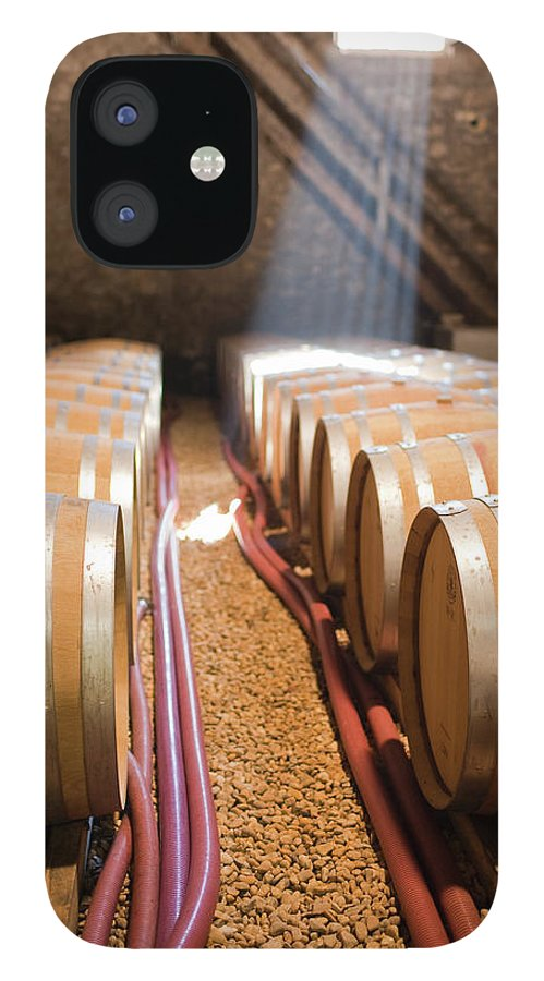 Alcohol IPhone 12 Case featuring the photograph Barrels In Wine Cellar by Johner Images