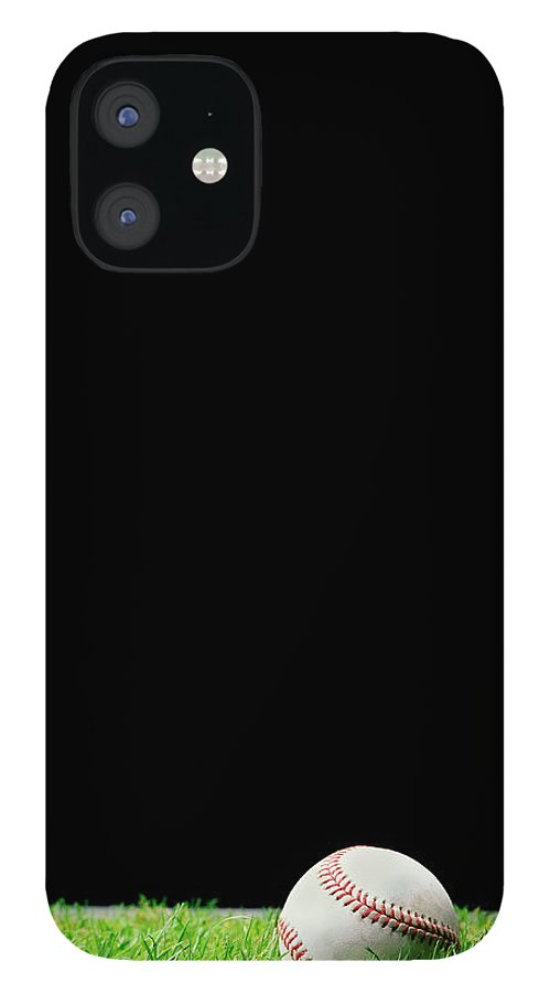 Grass IPhone 12 Case featuring the photograph Baseball On Grass At Night Time by Peter Dazeley
