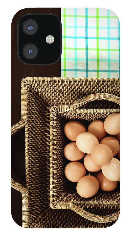 Large Group Of Objects iPhone 12 Case featuring the photograph Basket Of Brown Eggs by Joey Celis