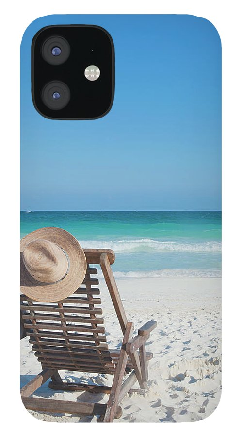 Scenics IPhone 12 Case featuring the photograph Beach Chair With A Hat On An Empty Beach by Sasha Weleber