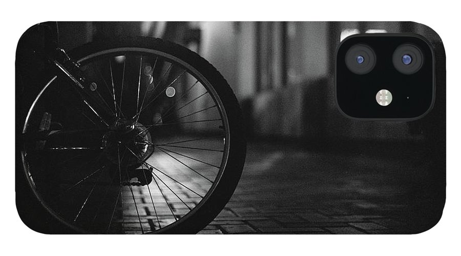 Shadow IPhone 12 Case featuring the photograph Bicycle In Dark Street by Satoshi Otani