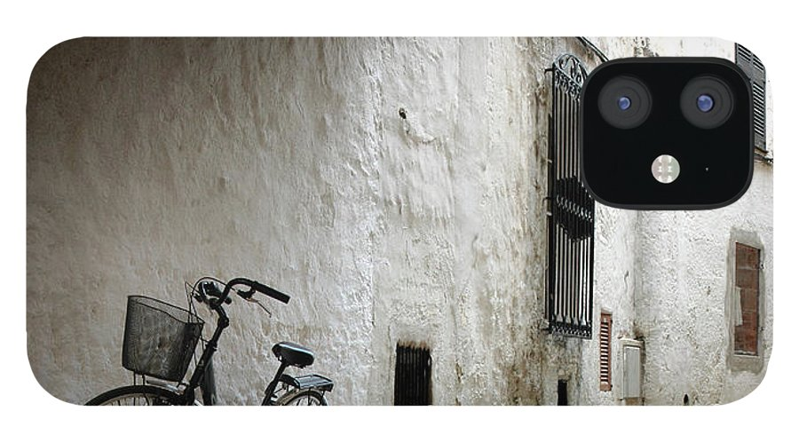 Tranquility IPhone 12 Case featuring the photograph Bicycle Leaning Wall by Antonio R. Ramos