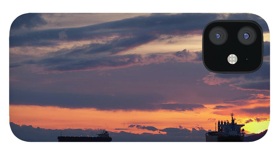 Scenics IPhone 12 Case featuring the photograph Big Boat Silhouettes by Visualcommunications