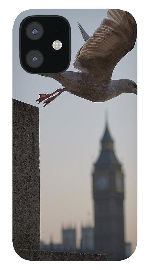 Clock Tower IPhone 12 Case featuring the photograph Bird Takeoff by Photograph © Jon Cartwright