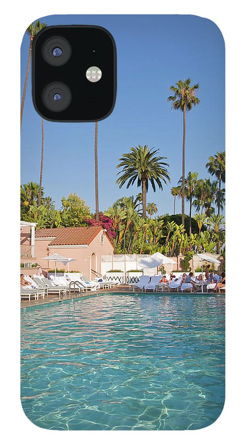Tranquility IPhone 12 Case featuring the photograph Blue-bottomed Pool Beneath Palm Trees by Barry Winiker