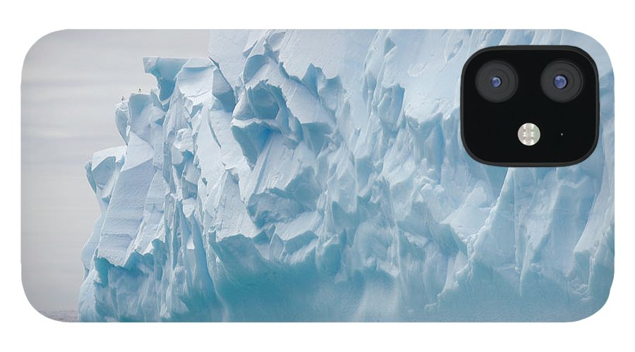 Scenics IPhone 12 Case featuring the photograph Blue Iceberg Carved By Waves Floats In by Eastcott Momatiuk