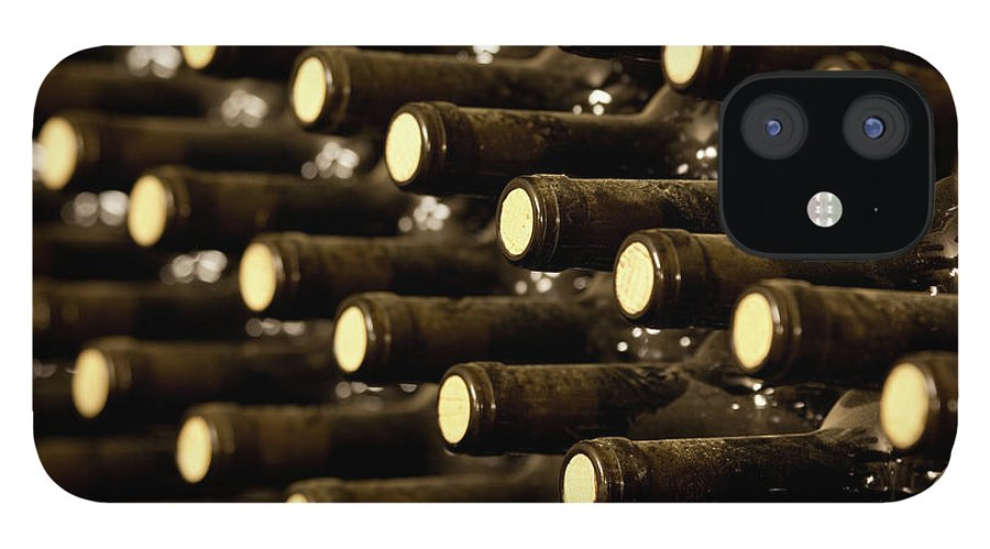 Stellenbosch IPhone 12 Case featuring the photograph Bottled Red Wine Aging In Wine Cellar by Siegfried Layda