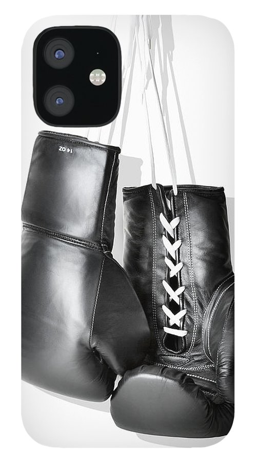 Hanging IPhone 12 Case featuring the photograph Boxing Gloves Hanging Against White by Burazin
