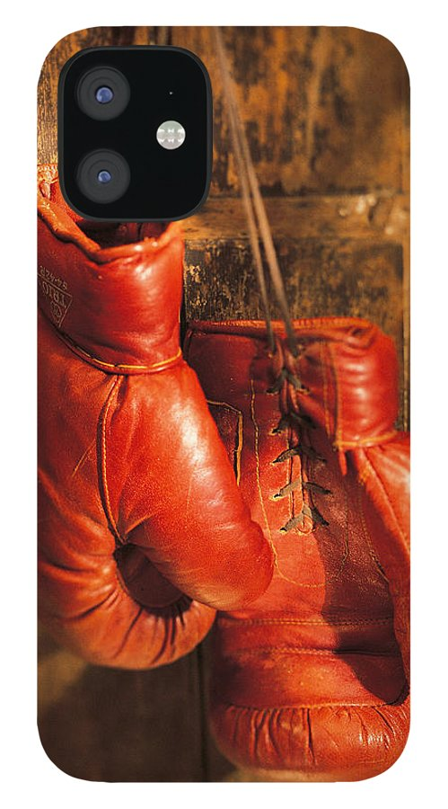 Hanging IPhone 12 Case featuring the photograph Boxing Gloves Hanging On Rustic Wooden by Comstock