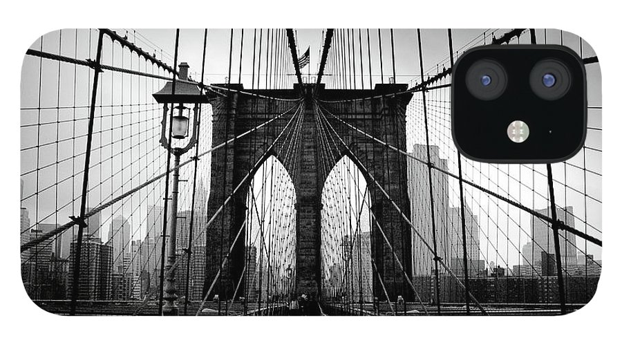 Clear Sky IPhone 12 Case featuring the photograph Brooklyn Bridge by Serhio.com Photography By Sergei Yahchybekov