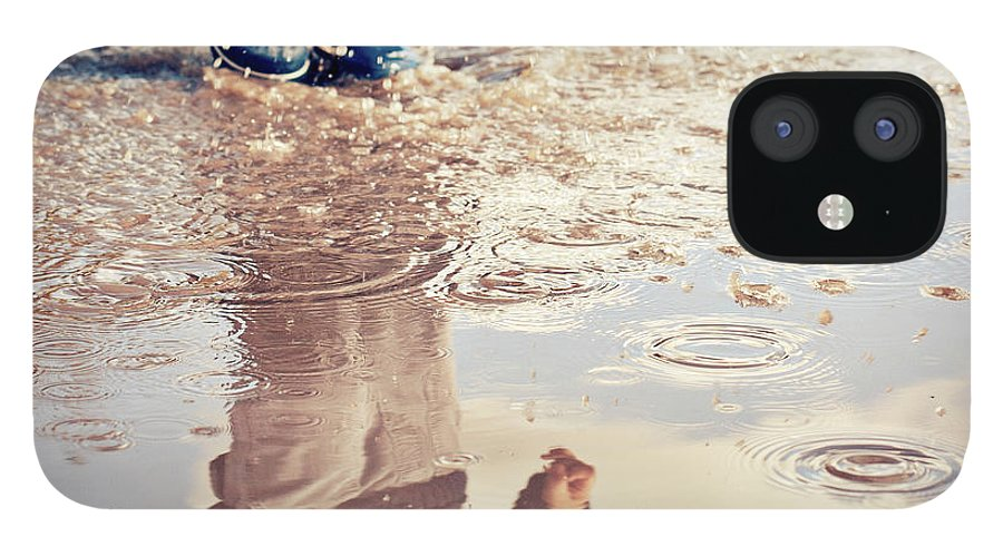 Toddler IPhone 12 Case featuring the photograph Child In A Puddle by Vpopovic