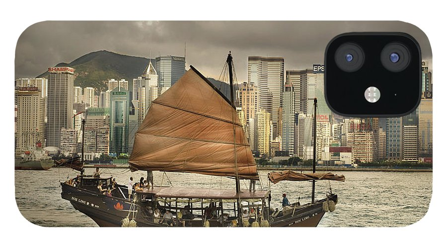 Sailboat IPhone 12 Case featuring the photograph China, Hong Kong, Junk Boat In Bay by Maremagnum