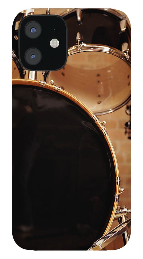 Microphone Stand IPhone 12 Case featuring the photograph Close-up Of A Drum Kit by Digital Vision.