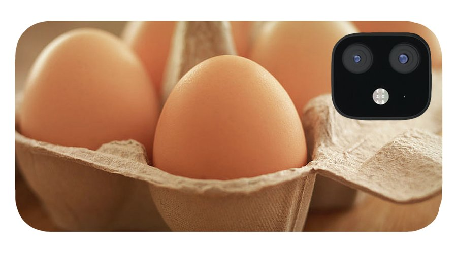 Free Range IPhone 12 Case featuring the photograph Close Up Of Brown Eggs In Carton by Adam Gault