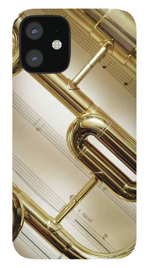 Sheet Music IPhone 12 Case featuring the photograph Close-up Of Trumpet by Medioimages/photodisc