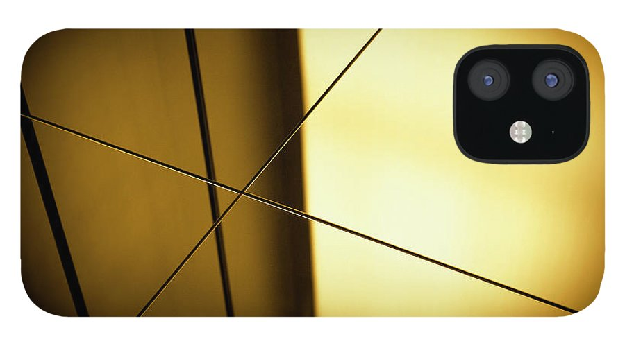 Shadow IPhone 12 Case featuring the photograph Close-up Spot Lit Reflection In Yellow by Ralf Hiemisch