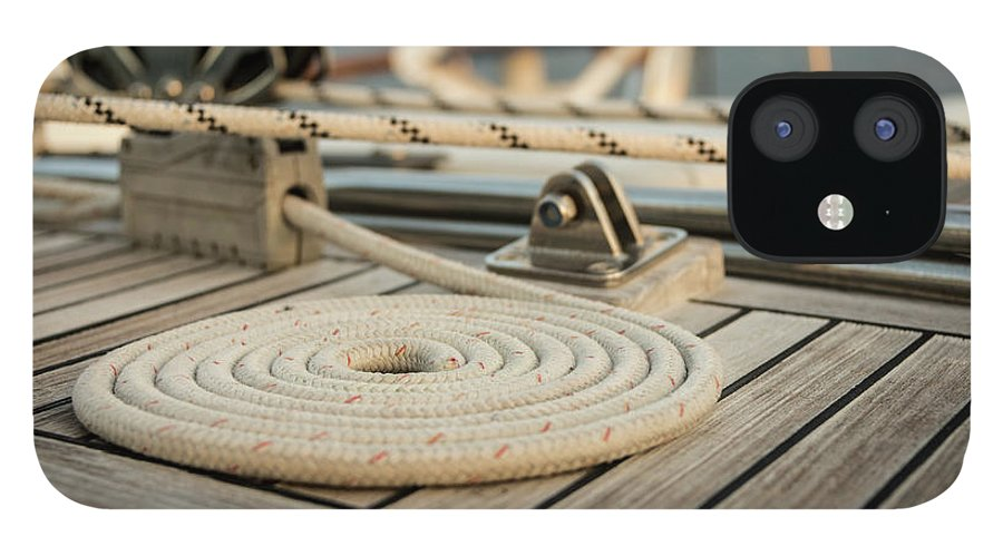Sailboat IPhone 12 Case featuring the photograph Coiled Line, Rope, On Teak Deck Of 62 by Gary S Chapman