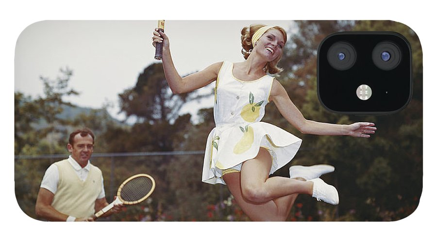 Heterosexual Couple IPhone 12 Case featuring the photograph Couple On Tennis Court, Woman Jumping by Tom Kelley Archive