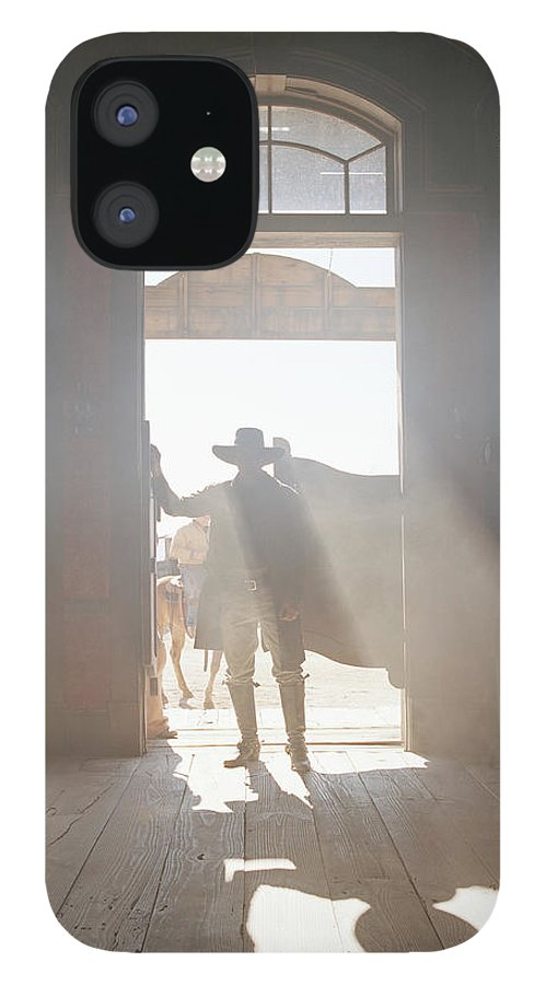 Shadow IPhone 12 Case featuring the photograph Cowboy At Saloon by Matthias Clamer