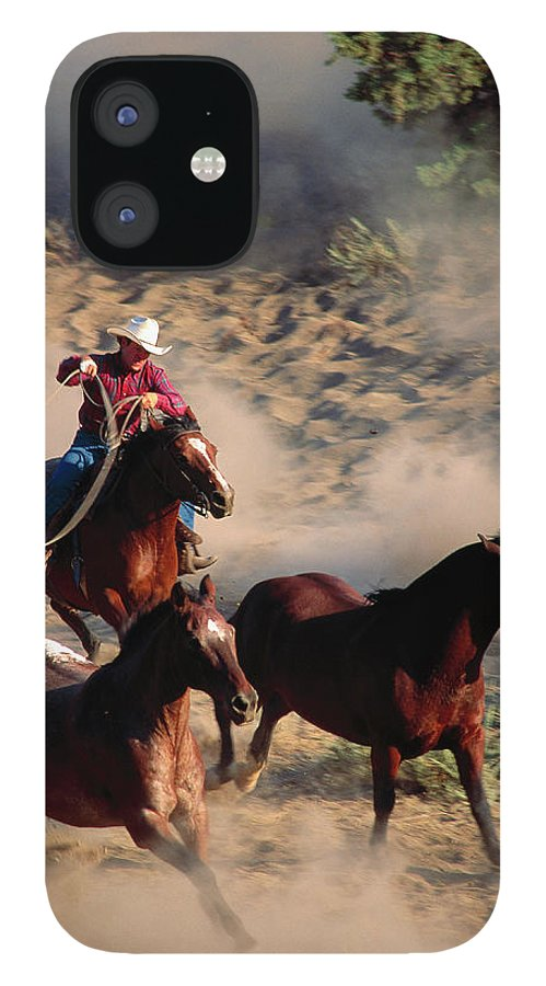 Horse IPhone 12 Case featuring the photograph Cowboy Roping Horses by John Luke
