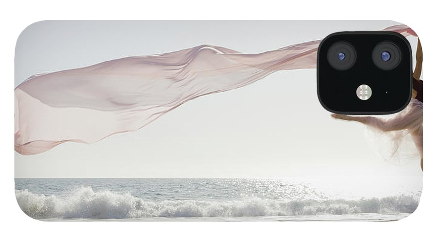 Ballet Dancer IPhone 12 Case featuring the photograph Dancer Leaping On Beach by Tetra Images - Pt Images