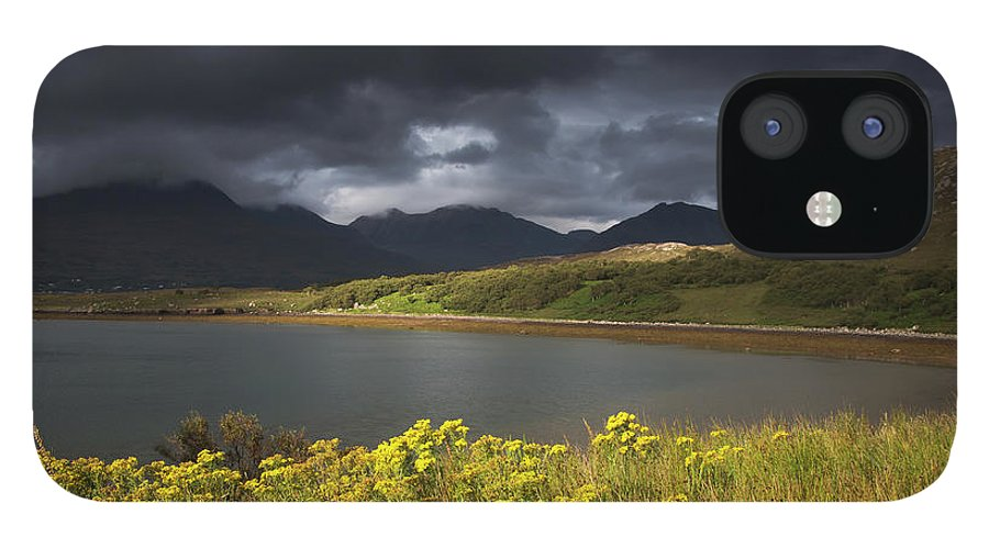 Tranquility IPhone 12 Case featuring the photograph Dark Storm Clouds Hang Over The by John Short / Design Pics