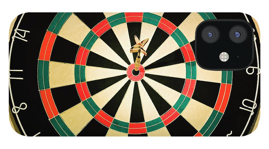 Expertise IPhone 12 Case featuring the photograph Dart In Bulls Eye On Dart Board by Fuse