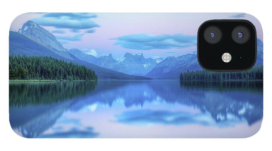 Moraine Lake IPhone 12 Case featuring the photograph Dusk On Maligne Lake by Bike maverick