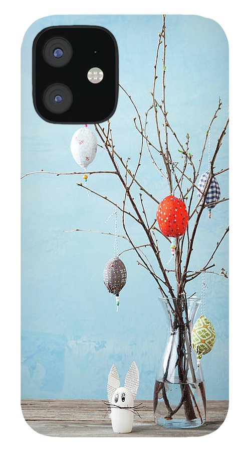Holiday IPhone 12 Case featuring the photograph Egg-shaped Decorations On Branches by Stefanie Grewel