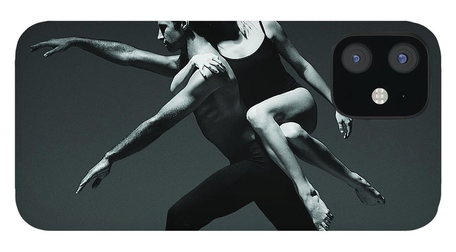 Expertise IPhone 12 Case featuring the photograph Female Dancer Holding Onto The Back Of by Chris Nash