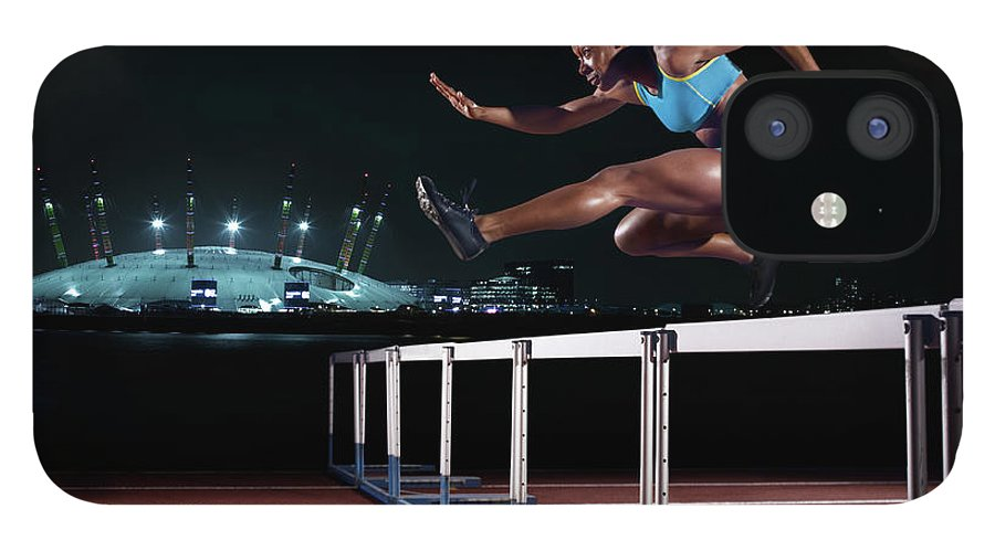 People IPhone 12 Case featuring the photograph Female Hurdling In London by Mike Harrington