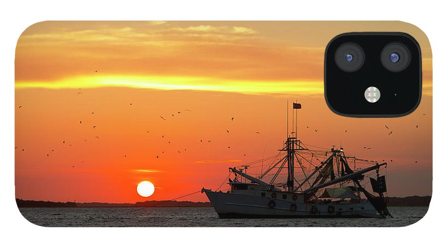 Water's Edge IPhone 12 Case featuring the photograph Fishing Boat At Sunset by Tshortell
