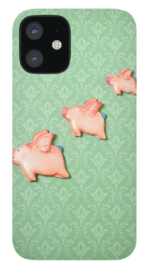 Disbelief IPhone 12 Case featuring the photograph Flying Pig Ornaments On Wallpapered by Peter Dazeley