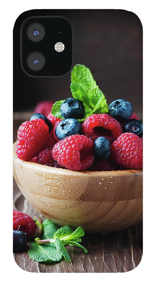 Vitamin IPhone 12 Case featuring the photograph Fresh Sweet Raspberry And Bluberry by Oxana Denezhkina