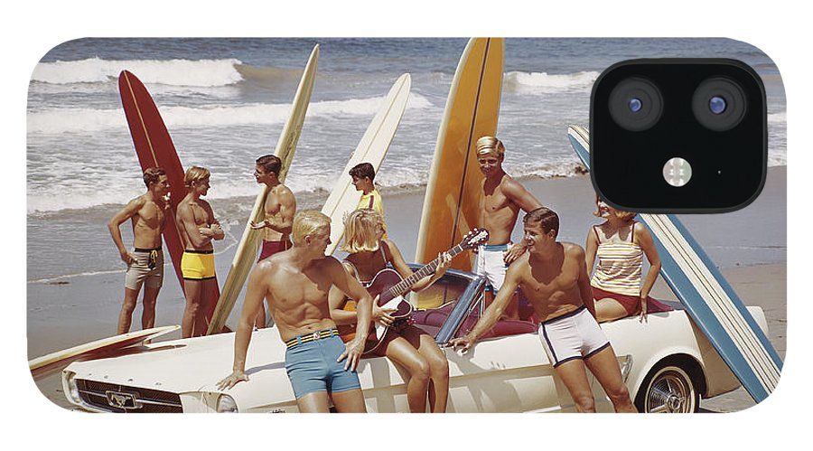 Young Men IPhone 12 Case featuring the photograph Friends Having Fun On Beach by Tom Kelley Archive