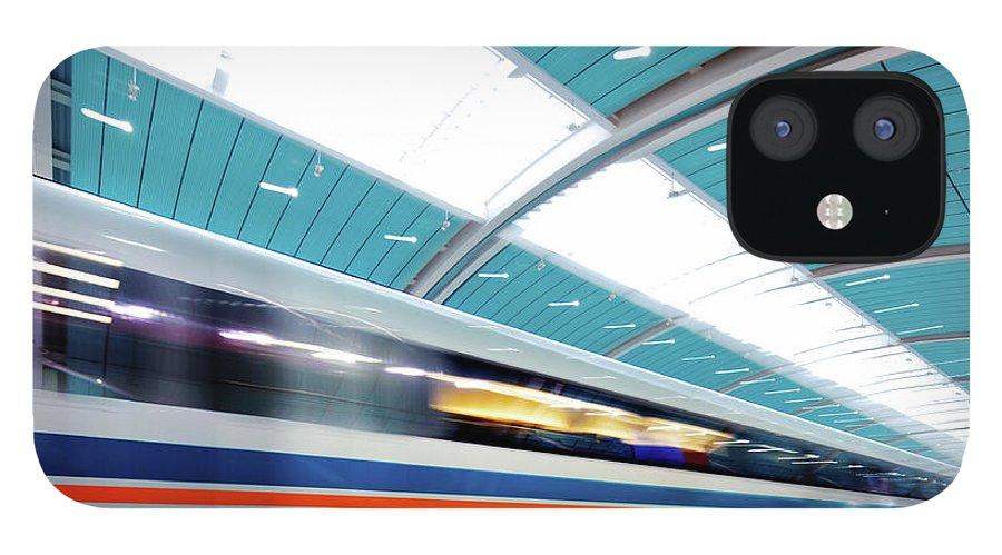 Aerodynamic iPhone 12 Case featuring the photograph Futuristic Train by Nikada