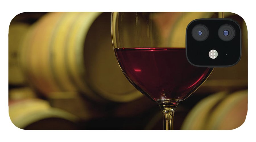 Stellenbosch IPhone 12 Case featuring the photograph Glass Of Red Wine In Wine Cellar by Siegfried Layda