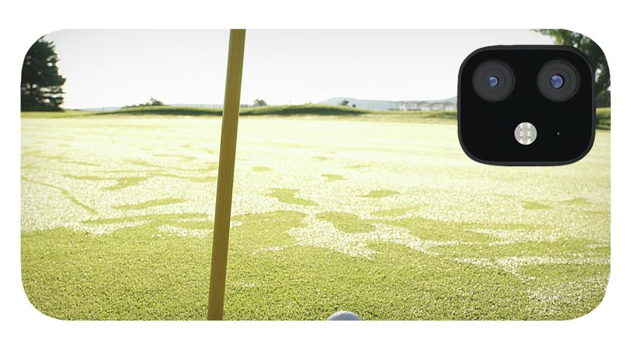 Grass IPhone 12 Case featuring the photograph Golf Ball Near Hole At Sunrise, High by Ascent/pks Media Inc.