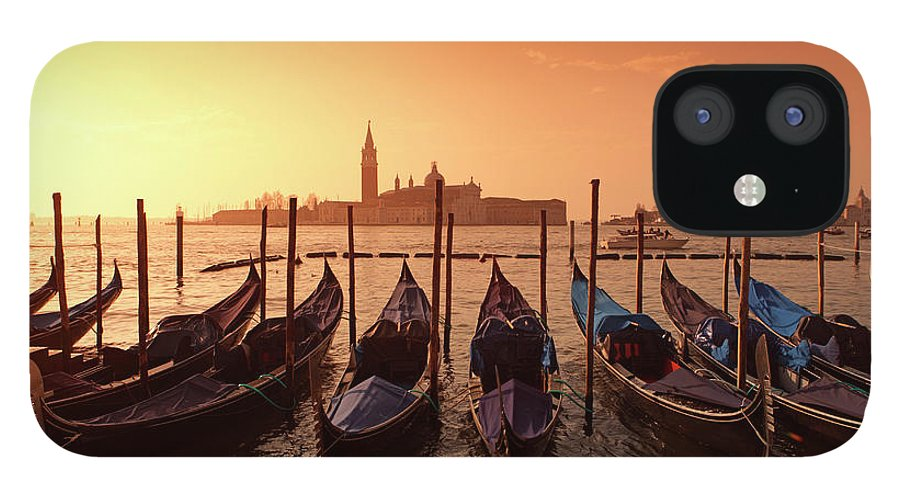 Scenics IPhone 12 Case featuring the photograph Gondolas And Saint George Major In by Massimo Pizzotti