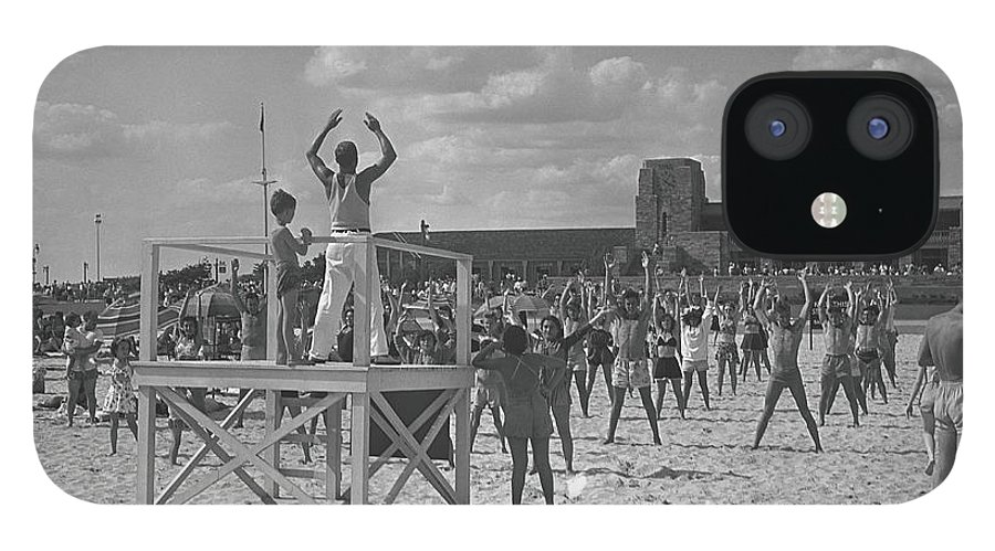 Human Arm IPhone 12 Case featuring the photograph Group Of People Exercising On Beach, B&w by George Marks