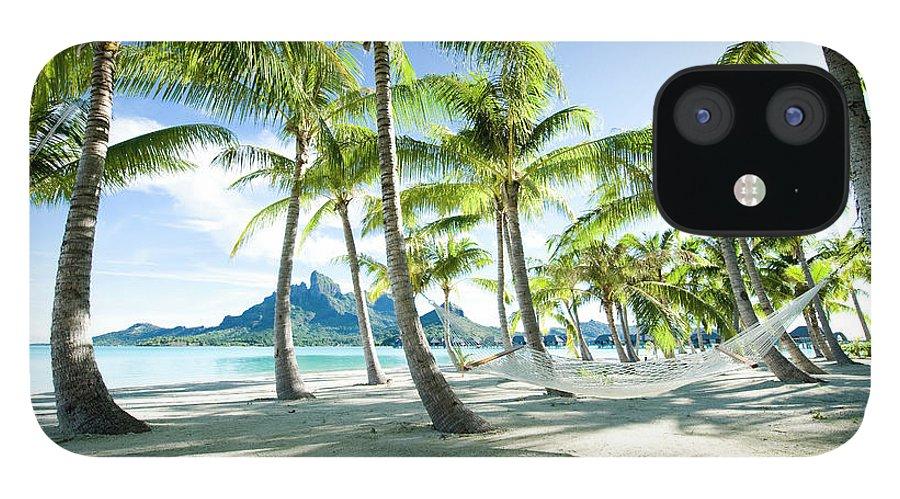 Hanging IPhone 12 Case featuring the photograph Hammock At Bora Bora, Tahiti by Yusuke Okada/amanaimagesrf