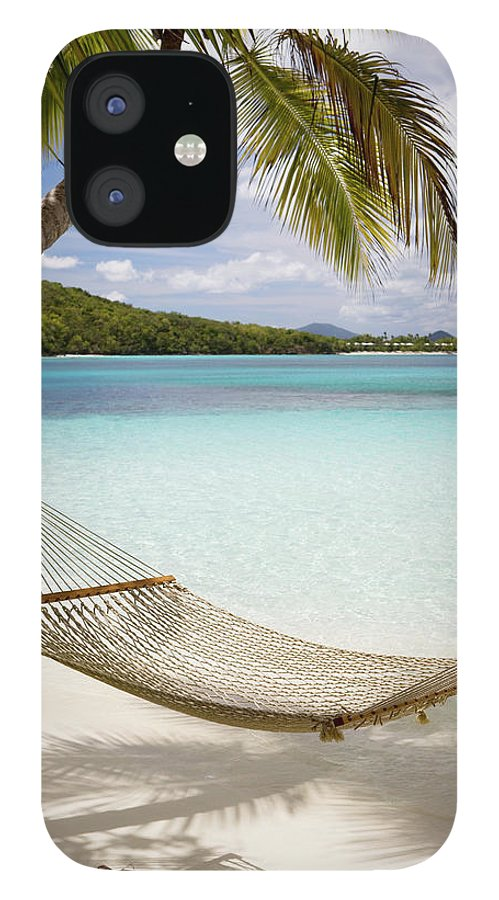 Water's Edge IPhone 12 Case featuring the photograph Hammock Hung On Palm Trees On A by Cdwheatley