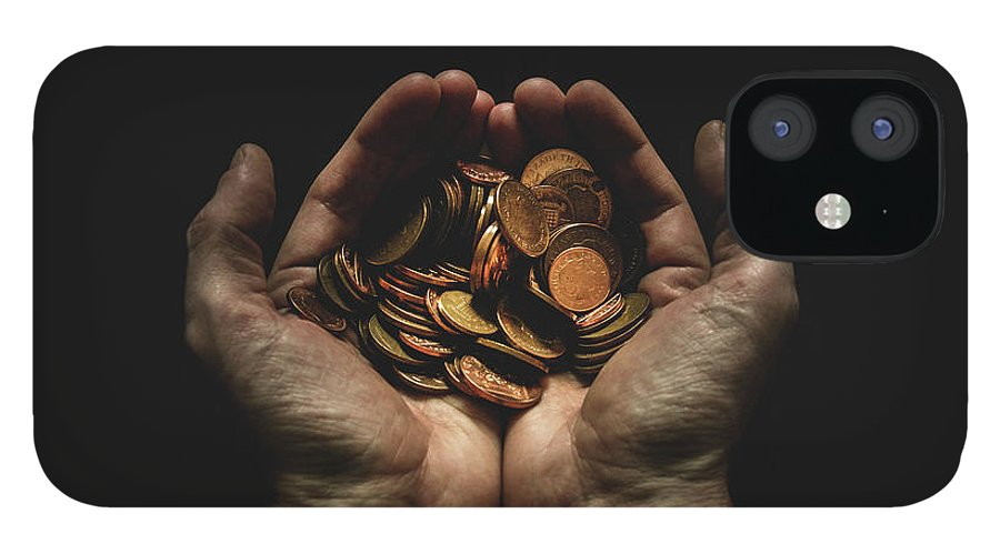 Coin IPhone 12 Case featuring the photograph Hands Holding Coins Against Black by Andy Kirby