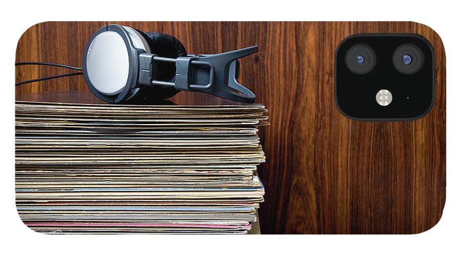 Technology IPhone 12 Case featuring the photograph Headphones Laying On Stack Of Vinyl by Steven Errico