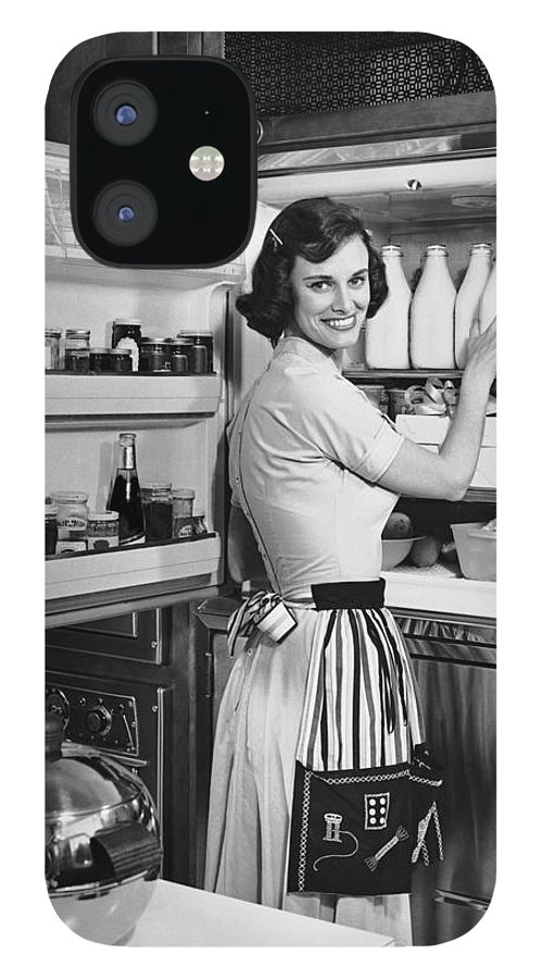 Milk IPhone 12 Case featuring the photograph House Wife Removing Milk From by George Marks