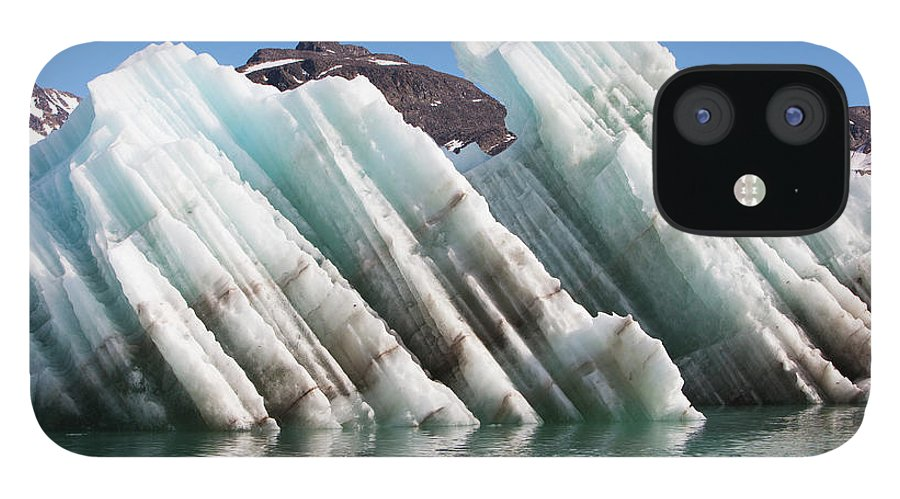 Iceberg IPhone 12 Case featuring the photograph Iceberg Streaked With Rock Debris by Anna Henly
