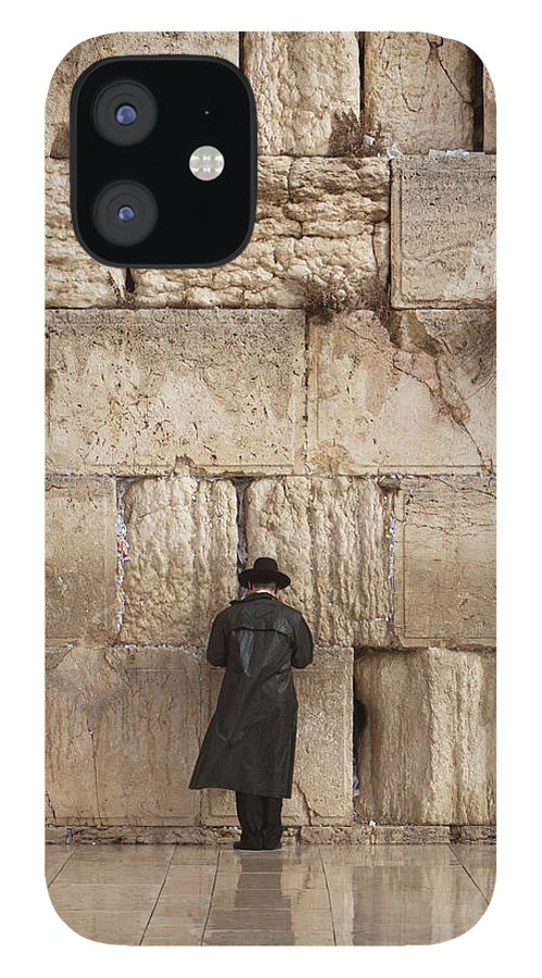 People IPhone 12 Case featuring the photograph Jewish Man Praying On The Wailing Wall by Richmatts
