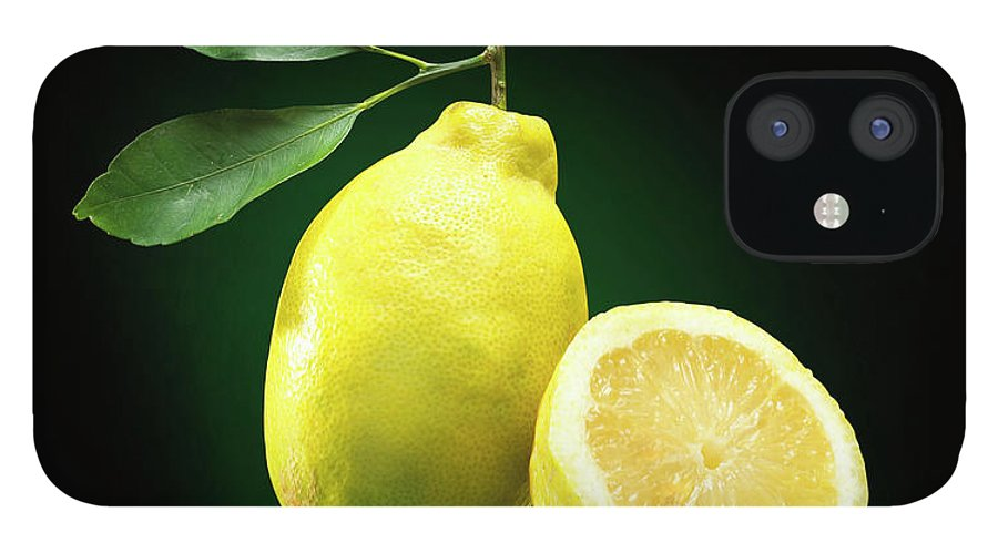 Black Background IPhone 12 Case featuring the photograph Lemon Slice by Jeremy Hudson