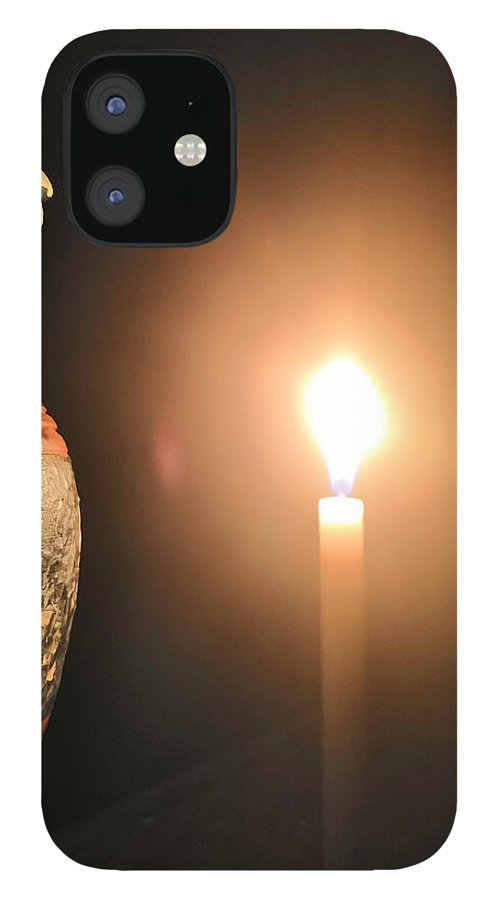 Candle Light IPhone 12 Case featuring the photograph Light in the dark by Ian Batanda