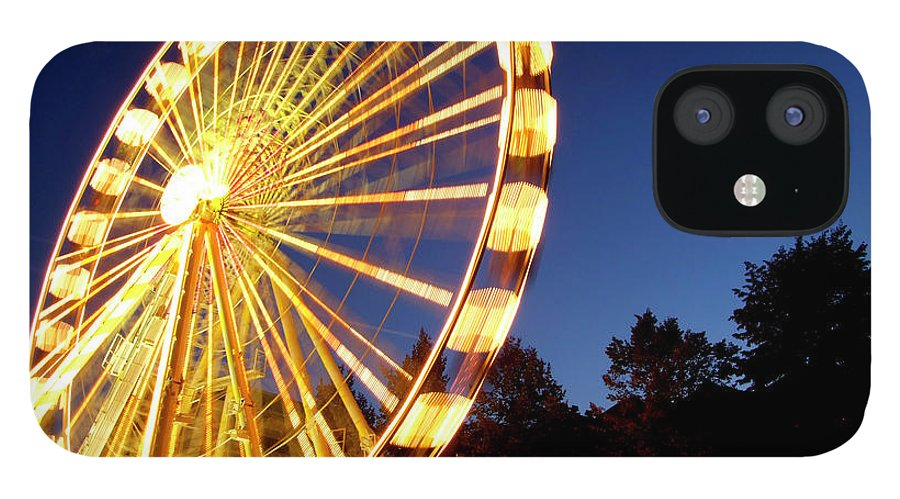 Curve iPhone 12 Case featuring the photograph Lighted Ferris Wheel Spinning In Motion by Vfka